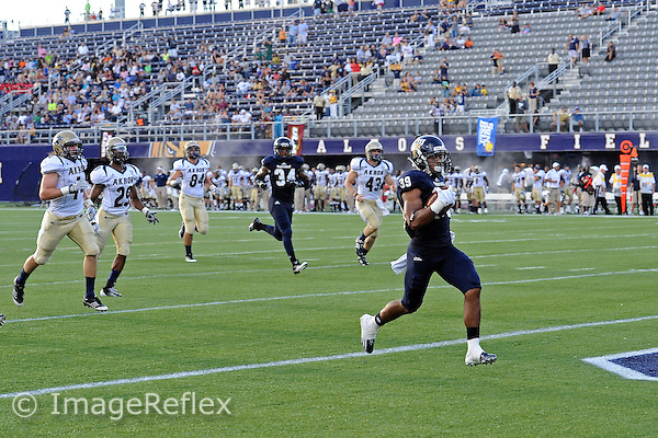 8 September 2012:  FIU cornerback Sam Miller (39) returns a punt for a touchdown, which was called back due to a penalty, as the FIU Golden Panthers defeated the Akron Zips, 41-38 (overtime), at FIU Stadium in Miami, Florida.