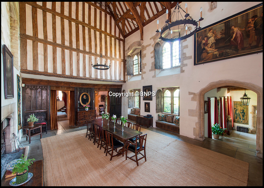 BNPS.co.uk (01202 558833)<br /> Pic: Savills/BNPS<br /> <br /> The grand hall is perfect for a Tudor banquet.<br /> <br /> A stunning country manor where Henry VIII and Anne Boleyn stayed during a royal tour is on the open market for the first time in its 500-year history.<br /> <br /> Little Sodbury Manor still has an impressive Great Hall that would be ideal for any Tudor banquet, but it also has modern comforts, like a heated swimming pool, for those that don't fancy medieval living.<br /> <br /> The Grade I listed property, set in 83 acres of beautiful gardens with far reaching views over Sodbury Vale in rural South Gloucestershire, is up for sale with Savills for the princely sum of £8million.
