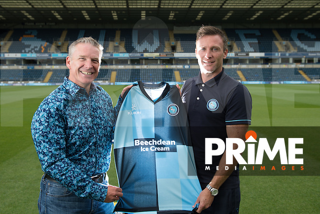 Garry Thompson of Wycombe Wanderers is handed a Home shirt by his sponsor during Wycombe Wanderers Team Photoshoot 2015  at Adams Park, High Wycombe, England on 3 August 2015. Photo by PRiME Media Images.