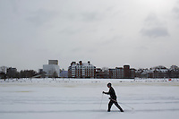 A man cross country skies along the Charles River in Cambridge, Massachusetts, USA, on Saturday, Feb. 9, 2013, after Winter Storm Nemo hit the area.
