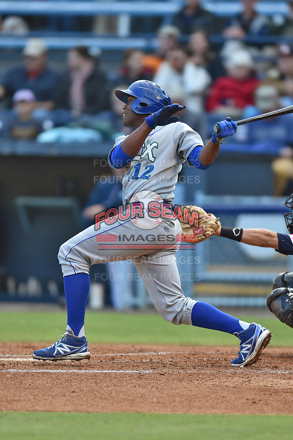 Lexington Legends right fielder Elier Hernandez #12 swings at a pitch during a game against the  Asheville Tourists at McCormick Field on May 16, 2014 in Asheville, North Carolina. The Tourists defeated the Legends 11-1. (Tony Farlow/Four Seam Images)