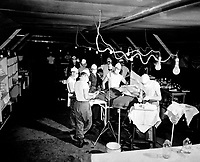 An operation is performed on a wounded soldier at the 8209th Mobile Army Surgical Hospital, twenty miles from the front lines.  August 4, 1952.  Feldman.  (Army)<br /> NARA FILE #  080-SC-409689<br /> WAR &amp; CONFLICT BOOK #:  1458