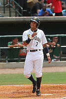 Charleston Riverdogs shortstop Cito Culver #2 touches home plate after scoring on a Gary Sanchez home run during the third inning a game against the Savannah Sand Gnats at Joseph P. Riley Jr. Park on May 16, 2012 in Charleston, South Carolina. Charleston defeated Savannah by the score of 14-5. (Robert Gurganus/Four Seam Images)