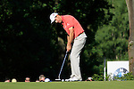 Padraig Harrington putts on the 16th green during Round 3 of the BMW PGA Championship at  Wentworth, Surrey, England, 22nd May 2010...Photo Golffile/Eoin Clarke.(Photo credit should read Eoin Clarke www.golffile.ie)....This Picture has been sent you under the condtions enclosed by:.Newsfile Ltd..The Studio,.Millmount Abbey,.Drogheda,.Co Meath..Ireland..Tel: +353(0)41-9871240.Fax: +353(0)41-9871260.GSM: +353(0)86-2500958.email: pictures@newsfile.ie.www.newsfile.ie.