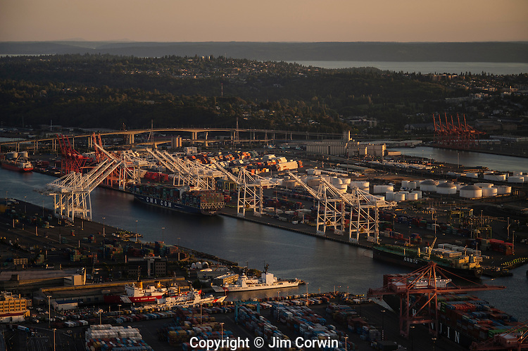 Port of Seattle with large cranes in a row and loading docks for imported and exported goods Seattle waterfront Seattle Washington State USA
