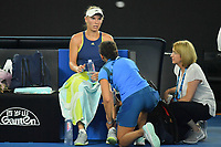 January 27, 2018: Number two seed Caroline Wozniacki of Denmark receives attention from the trainer during the Women's Final against number one seed Simona Halep of Romania on day thirteen of the 2018 Australian Open Grand Slam tennis tournament in Melbourne, Australia. Photo Sydney Low