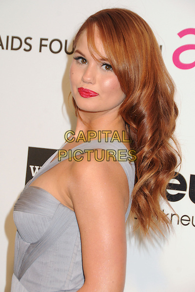 Debby Ryan.21st Annual Elton John Academy Awards Viewing Party held at West Hollywood Park, West Hollywood, California, USA..February 24th, 2013.oscars headshot portrait red pink lipstick blue sheer side .CAP/ADM/BP.©Byron Purvis/AdMedia/Capital Pictures.
