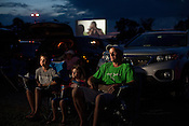 10-yr old Chas Chappell, left, and his sister Cate Chappell (7-yrs), middle, and their father Chuck Chappell, right, all of South Riding, Virginia, watch a movie at Family Drive-In Theatre in Stephens City, Virginia on July 20, 2013. CREDIT: Lance Rosenfield/Prime