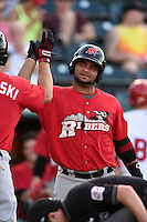 Frisco Rough Riders designated hitter Tomas Telis (13) high fives outfielder Jake Smolinski (3) after scoring a run during a game against the Springfield Cardinals on June 1, 2014 at Hammons Field in Springfield, Missouri.  Springfield defeated Frisco 3-2.  (Mike Janes/Four Seam Images)