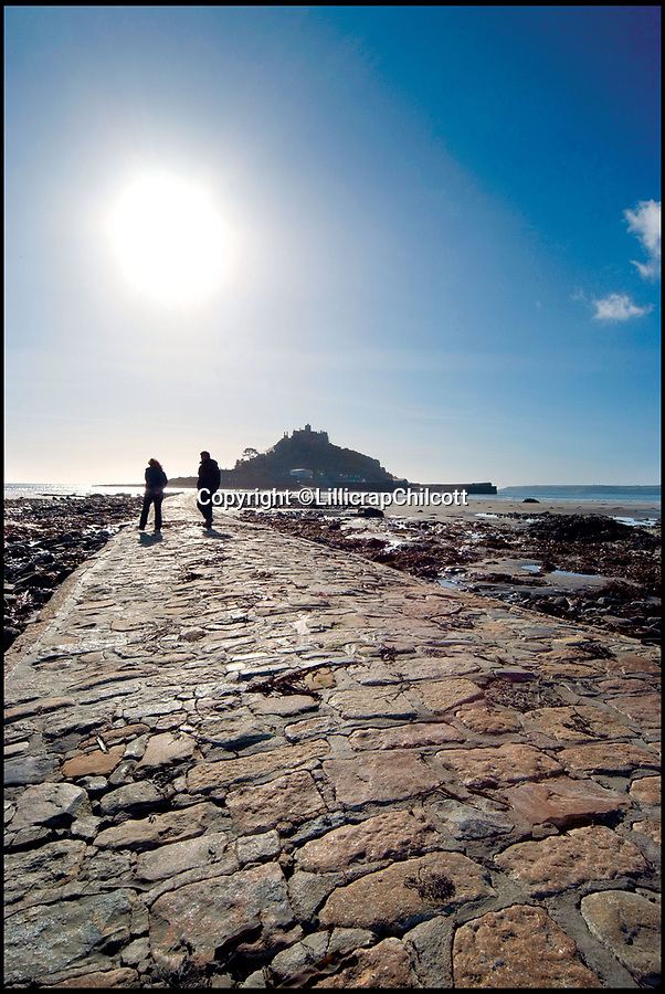 """BNPS.co.uk (01202 558833)Pic: LillicrapChilcott/BNPS<br /> <br /> St Michael's Mount from the stunning Spinnakers in Marazion, Cornwall.<br /> <br /> Room with a (360) view...<br /> <br /> This striking £1.15m Art Deco style house that has some of the best views in Cornwall comes with an extra surprise - a spinning roof pod that offers 360-degree views.<br /> <br /> The stunning Spinnakers in Marazion, Cornwall's oldest town, sits in an elevated position overlooking the beautiful Mount's Bay and the hugely popular tourist attraction St Michael's Mount, with panoramic views from most of the rooms.<br /> <br /> But the real wow factor comes from the unparalleled vistas the new owners will be able to soak up from the roof terrace and a rotating pod room that allows them to enjoy the view even in bad weather.<br /> <br /> The house is now on the market with estate agents Lillicrap Chilcott, who describe the outlook as """"truly mesmerising""""."""