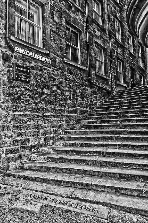 Looking at the base of Advocate's Close in Edinburgh in B&W.