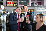 © Joel Goodman - 07973 332324 . 11/04/2015 . Bury , UK . Labour Shadow Ed Balls (l) and James Frith (c) , Labour candidate for Bury North , at a campaign stop with the owner of Barista coffee shop (r) at The Rock , Bury in Greater Manchester , UK . The pair met parents and discussed family finances . Photo credit : Joel Goodman