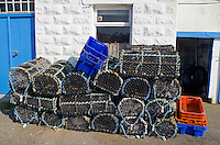 Lobster and crab pots stacked on the quayside ready to be loaded onto the boat in Newlyn Harbour Cornwall..©shoutpictures.com..john@shoutpictures.com