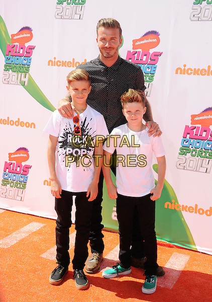 LOS ANGELES, CA- JULY 17: Former soccer player David Beckham, sons Romeo James Beckham (L) and Cruz David Beckham attend Nickelodeon Kids' Choice Sports Awards 2014 at Pauley Pavilion on July 17, 2014 in Los Angeles, California.<br /> CAP/ROT/TM<br /> &copy;Tony Michaels/Roth Stock/Capital Pictures