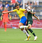 Beatriz of Brazil (left) heel kicks the ball as she's guarded by Alanna Kennedy of Australia In the first of two Tournament of Nations games at Children's Mercy Park in Kansas City, Kansas on July 26, 2018.<br /> Photo by Tim Vizer