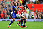 Danny Simpson of Leicester City challenges Marcus Rashford of Manchester United during the Premier League match at Old Trafford Stadium, Manchester. Picture date: September 24th, 2016. Pic Sportimage