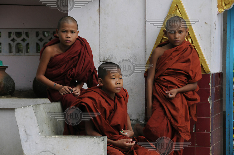 12 year old Ashin Zanaka (left), a novice monk from laputta district in Ayeyarwaddy, shelters in a monastery in the Shwe Pyi Thar suburb of Yangon. He lost his three sisters, his father and one of his brothers in Cyclone Nargis. Only his mother and older brother survived. His mother is devastated but still insisted that he stay at the monastery, as it is not right for a monk to live in a normal home. Cyclone Nargis hit Burma on 02/05/2008.