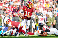 Landover, MD - November 4, 2018: Washington Redskins quarterback Alex Smith (11) escapes the pocket and picks up a first down during game between the Atlanta Falcons and the Washington Redskins at FedEx Field in Landover, MD. The Falcons defeated the Redskins 38-13. (Photo by Phillip Peters/Media Images International)