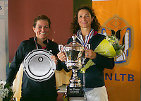 August 24, 2014, Netherlands, Amstelveen, De Kegel, National Veterans Championships, Prizegiving, Final 45 years+: winner Mariëlle Spekreijsel (NED) (R) and runner up Sandy Wenderhold (NED)<br /> Photo: Tennisimages/Henk Koster