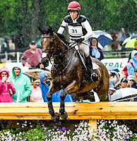 LEXINGTON, KENTUCKY - APRIL 29: Truly Wiley #31, with rider Kelly Prather (USA), brave the rain as they clear an obstacle during the Cross Country Test at the Rolex Kentucky 3-Day Event at the Kentucky Horse Park on April 29, 2017 in Lexington, Kentucky. (Photo by Scott Serio/Eclipse Sportswire/Getty Images)