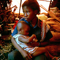 16 year old Rikizi and her baby born as a result of her rape. An estimated 250,000 women have been victims of sexual violence during the Democratic Republic of Congo's civil war. In the eastern states of the country a recent peace agreement struggles to keep warring factions from fighting, and as the chaos that accompanies war continues, so does the rape of women in the area..©Robin Hammond/PANOS/Felix Features