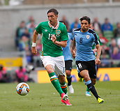 June 4th 2017, Aviva Stadium, Dublin, Ireland; International football friendly, Republic of Ireland versus Uruguay; Stephen Ward (Republic of Ireland) gets to the ball ahead of Jonathan Urretaviscaya (Uruguay)