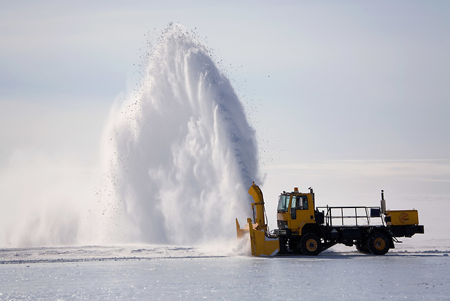 Large Snow Blower clearing snow off the Blue Ice Runway at Patriot Hills. Antarctica