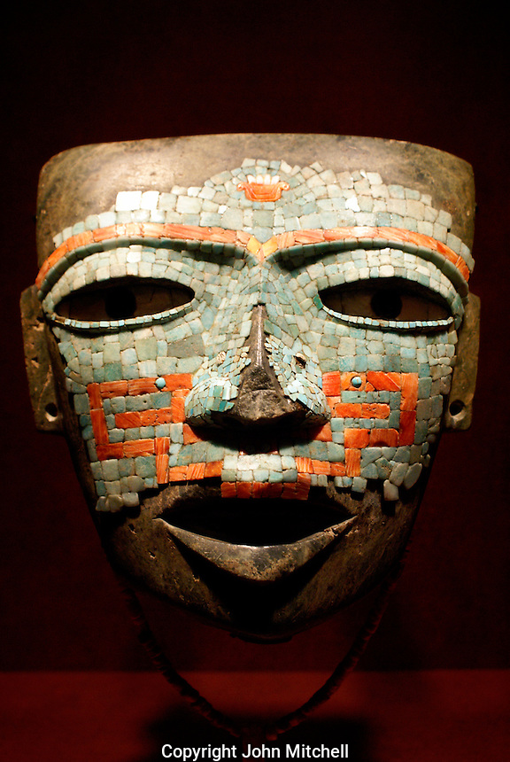 Mascara de Malinaltepec, a mosaic mask from Guerrero, Mexico. Museo Nacional de Antropologia, Chapultepec Park, Mexico City. This exquisite funnery mask is encrusted with jade, turquoise, shell, and pyrite.