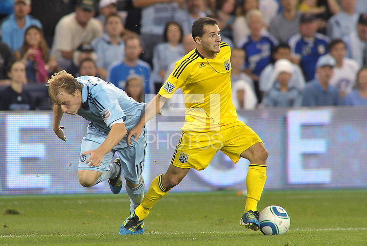 Dilly Duka (yellow) Columbus Crew midfielder holds off Sporting KC defender Seth Sinovic... Sporting Kansas City defeated Columbus Crew 2-1 at LIVESTRONG Sporting Park, Kansas City, Kansas.