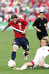 28 May 2006: U.S. midfielder John O'Brien (5) has the ball tackled by Latvia's Genadijs Solonicins (15). The United States Men's National Team defeated Latvia 1-0 at Rentschler Field in East Hartfort, Connecticut in an international friendly soccer match.