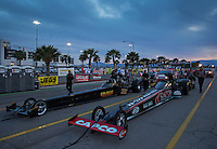Apr. 5, 2013; Las Vegas, NV, USA: NHRA top fuel dragster driver Steve Torrence (right) lines up alongside Troy Buff in the staging lanes during qualifying for the Summitracing.com Nationals at the Strip at Las Vegas Motor Speedway. Mandatory Credit: Mark J. Rebilas-