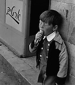 Child enjoying an ice-cream cone