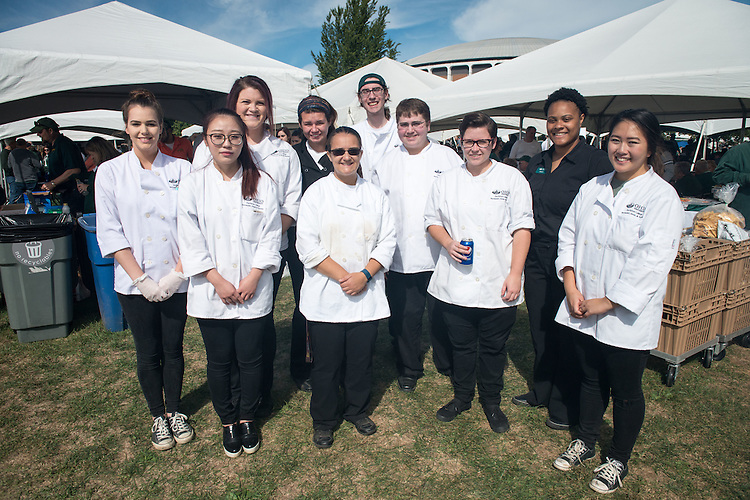 Servers of the College of Education homecoming tent pose at Tailgreat Park on Saturday, October 8, 2016.