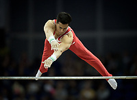 Eddy Yusof (SUI) in action during the men's Horizontal Bar competition.  FIG World Cup Series of Gymnastics. The O2 Arena, London,  Britain 8th April 2017.