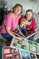 UNP 25407/Yours Magazine?Issue 92 (June 29): Sandy Bannister - Memory Books??Sandy Bannister , her daughter Katie and Katie' daughter Grace. ??Sandy, Katie and Grace looking at albums (Sandy's wedding album,.Katie's album from childhood done by Sandy -- and the WI album)??They have found the perfect way to.tell their family story and preserve it for future generations with treasured old family photos.??Date Taken: 121/06/10??Location:?Mossat Cottage?Halnaker?Chichester.PO18 0NF??Contact: Sandy Bannister 01243 773396??Commissioned by:  UNP?Mandy Taylor?UNP Ltd.24 Victoria Road,.Saltaire,.BD18 3JR.England, UK.P 01274 412222.F 01274 590999.iSDN 01274 420446.email: mandy@unp.co.uk