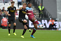 Sebastien Haller of West Ham United and Kevin De Bruyne of Manchester City during West Ham United vs Manchester City, Premier League Football at The London Stadium on 10th August 2019