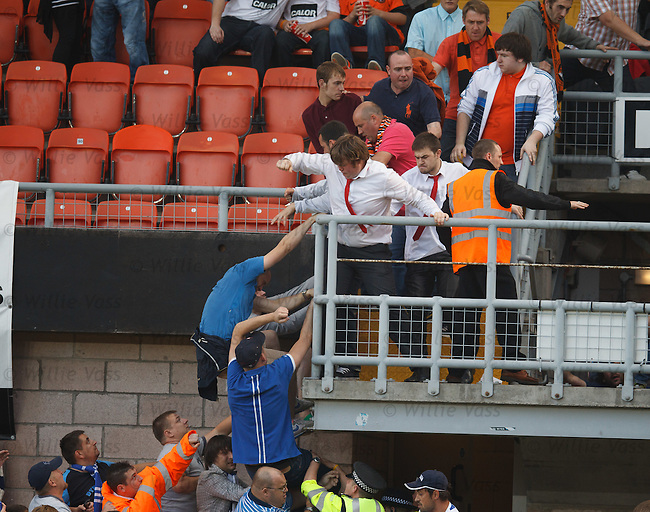 Russian fans climbing up from the lower tiers of the stand to fight with Dundee Utd fans