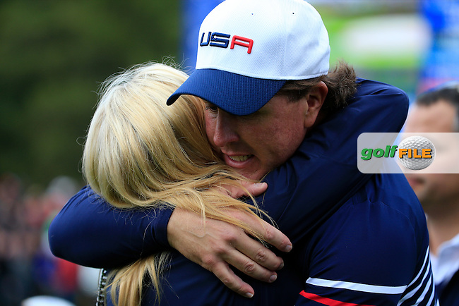 Phil Mickelson (USA) embraces his wife Amy during the Sunday Singles Matches at the 2014 Ryder Cup at Gleneagles. The 40th Ryder Cup is being played over the PGA Centenary Course at The Gleneagles Hotel, Perthshire from 26th to 28th September 2014.: Picture Fran Caffrey, www.golffile.ie: \28/09/2014\