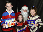 Alex, Katie and Lauren Connolly pictured with Santa at the Castle Manor childrens Christmas party in the Rugby Club. Photo:Colin Bell/pressphotos.ie