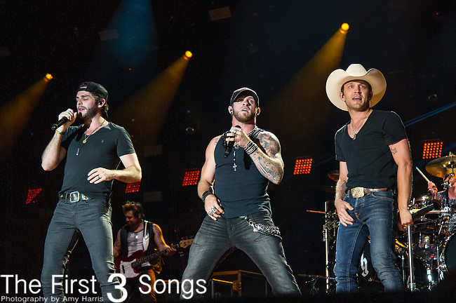Brantley Gilbert, Thomas Rhett, and Justin Moore perform at LP Field during Day One of the 2014 CMA Music Festival in Nashville, Tennessee.