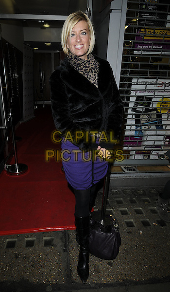 "CAROLINE FERADAY .At ""An Evening With Kate Robbins"" special gig, 100 Club, Oxford Street, London, England, March 9th 2011..full length black fur jacket coat purple dress tights boots leopard brown print scarf animal .CAP/CAN.©Can Nguyen/Capital Pictures."