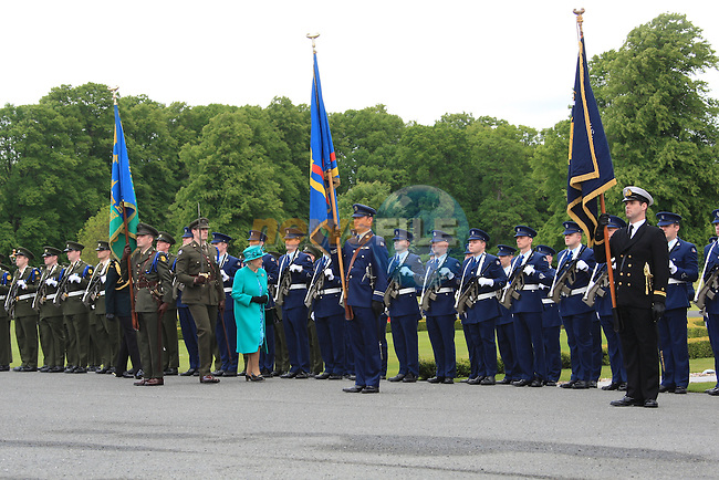 HM Queen Elizabeth II is escorted to salute point by Defence Forces Chief of Staff Lt Gen Sean McCann and GOC 2nd Eastern Brigade, Brig Gen Denis Murphy. Capt Thomas Holmes invites the Queen to inspect the guard of honour drawn from the two eastern brigade, air corps and naval service. 17th May 2011 Áras an Uachtaráin, Phoenix Park, Dublin..Picture Fran Caffrey/www.newsfile.ie