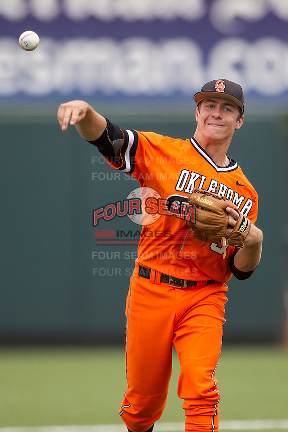 Oklahoma State Cowboys shortstop Donnie Walton #5 makes a throw to third base during the NCAA baseball game against the Texas Longhorns on April 26, 2014 at UFCU Disch–Falk Field in Austin, Texas. The Cowboys defeated the Longhorns 2-1. (Andrew Woolley/Four Seam Images)