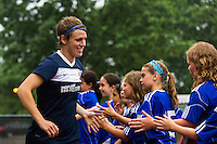 Sky Blue FC midfielder Sophie Schmidt (16) greets fans before the game. Sky Blue FC and the Boston Breakers played to a 0-0 tie during a National Women's Soccer League (NWSL) match at Yurcak Field in Piscataway, NJ, on July 13, 2013.