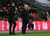 9th December 2017, Wembley Stadium, London England; EPL Premier League football, Tottenham Hotspur versus Stoke City; Stoke City Manager Mark Hughes looking disappointed from the touchline during the 2nd half with Tottenham Hotspur Manager Mauricio Pochettino also looking on from the touchline