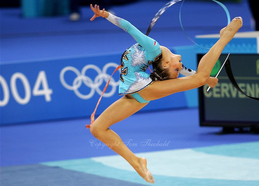 Dominika Cervenkova of Czech Republic...stag leaps with ribbon during qualifications round at Athens Olympic Games on August 27, 2004 at Athens, Greece. (Photo by Tom Theobald)