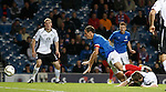 Lee McCulloch taken down for a ;enalty kick by Chris Higgins
