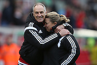 Swansea City Manager, Francesco Guidolin celebrates with physic Kate Rees during the Barclays Premier League match between Stoke City and Swansea City played at Britannia Stadium, Stoke on April 2nd 2016