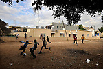 Eritrean asylum-seeker youth play football near their temporary shelter in southern Tel Aviv, Israel.