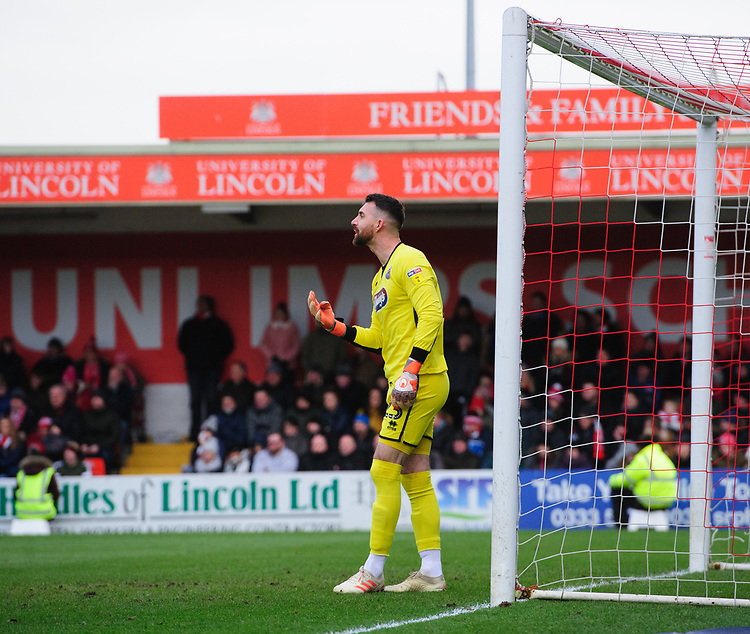 Grimsby Town's Sam Russell<br /> <br /> Photographer Chris Vaughan/CameraSport<br /> <br /> The EFL Sky Bet League Two - Lincoln City v Grimsby Town - Saturday 19 January 2019 - Sincil Bank - Lincoln<br /> <br /> World Copyright &copy; 2019 CameraSport. All rights reserved. 43 Linden Ave. Countesthorpe. Leicester. England. LE8 5PG - Tel: +44 (0) 116 277 4147 - admin@camerasport.com - www.camerasport.com
